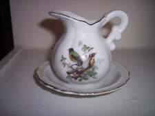 A Small Pitcher in a Bowl Made in Japan - Birds