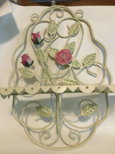 """vintage metal wall shelf 15"""" tall X 10 1/2"""" wide. folds flat. Cream / red roses"""