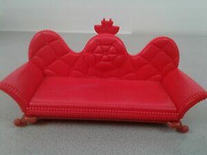 "Disney red plastic dollhouse sofa 5 3/4"" long"
