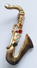 broche bijou vintage couleur or instrument de musique cristaux de couleur 604
