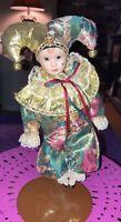 "Porcelain Jester Harlequin Baby Face Clown doll 9"" green/gold glitter Mardi Gras"