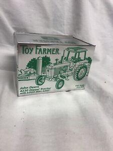 Ertl Toy Farmer John Deere 4230 Diesel Tractor with 4-Post Roll Gard 1:43
