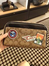 COACH 75915 OVERNIGHT TRAVEL KIT IN SIGNATURE CANVAS WITH NYC TRAVEL PATCHES