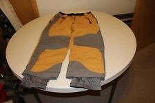 Men's yellow and grey Obermeyer snow pants size medium short in good condition.