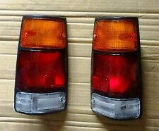 ISUZU OPEL CAMPO UTE MODEL 1988 93 96 TAIL LIGHTS PAIR LH RH BLACK FRAME NEW