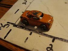 vintage orange tiny car, diecast or slush