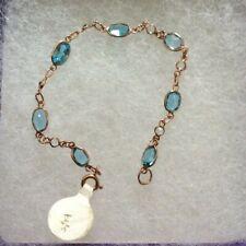 NEW IN BOX. 9CT ROSE GOLD BRACELET SET WITH BLUE TOPAZ