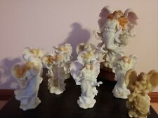 Roman Angels Serephim Figurines and one music box. Used.