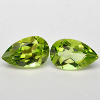 A SET OF TWO 6x4mm PEAR-FACET STRONG-GREEN NATURAL AFGHAN PERIDOT GEMSTONES