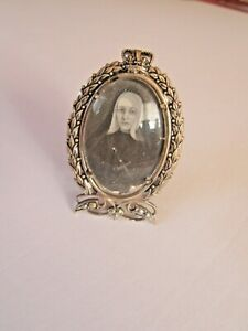"""2"""" X 1 1/4"""" TINY EASEL FRAME WITH DOMED GLASS pictures a NUN"""