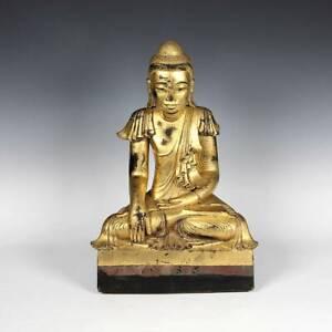 SEATED FIGURE OF BUDDHA BHUMISPARSHA MUDRA GILDED TEAK BURMA 19TH / 20TH C.