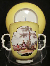 More details for meissen porcelain twin handled  yellow ground scenic beaker & saucer. 1735-40