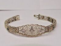 14 KT white gold bracelet with diamonds and emeralds