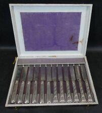 12 Messer mit silbernen Griffen um 1890 nicht gepunzt
