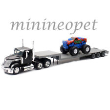NEW RAY LONG HAUL TRUCKER INTERNATIONAL LONESTAR FLATBED with MONSTER TRUCK 1/43