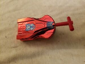 Red metallic ~ String Launcher ~ Tomy ~ Beyblade. 2010.  Works great!