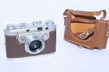 Bell & Howell FOTON vintage 35mm film camera body only with half case. Scarce.