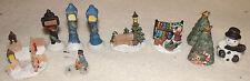 11 piece christmas miniature lamp post, xmas trees, snowman, corner fence etc.