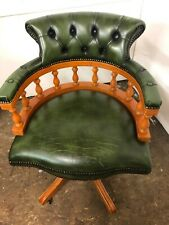 Captain chair in green leather