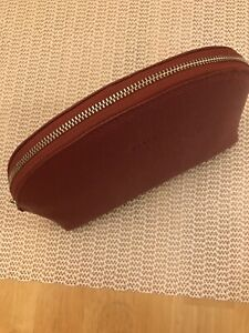 New In Box Dark Red Leather Bally Makeup Bag.