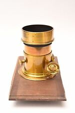 Vintage brass lens Darlot with iris aperture and lensboard. Good condition.