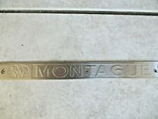 MONTAGUE EMBOSSED METAL ADVERTISING EMBLEM SIGN, BICYCLE OR COOKING EQUIPMENT