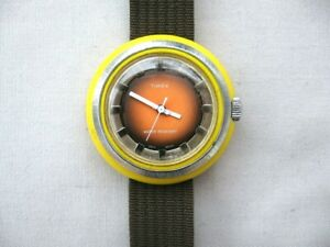 Timex rare vintage yellow plastic cased mechanical.Good,clean working condition.