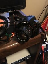 sony alpha slt a33 with 4 lenses, 2 batteries and battery charger
