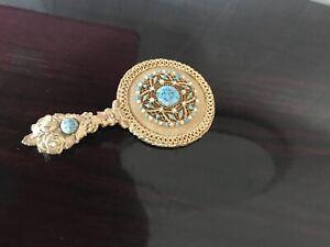 Vintage Hand Vanity Held Brass Mirror .