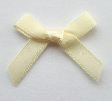 10 RIBBON BOWS  ( CREAM ).
