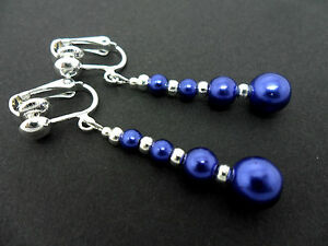 A PAIR OF DANGLY BLUE GLASS PEARL  SILVER PLATED CLIP ON   EARRINGS.
