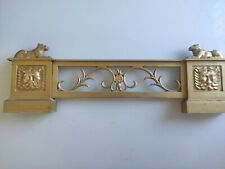 Fireplaces, mantels and fireplace accessories golden art deco carved lion head.