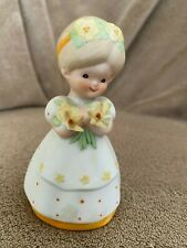 porcelain girl doll and bell