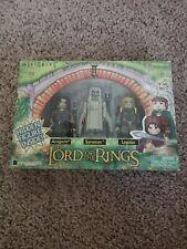 Lord of the rings minimates. Aragorn, Legolas, Saruman plus a hidden figure.