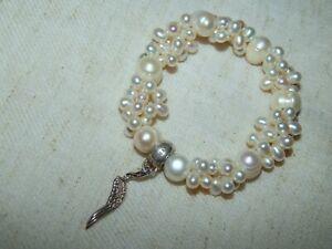 Perlen Armband mit Flügel Charm von Thomas Sabo . Top