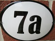 Hausnummer Oval Emaille schwarze Zahl Nr. 7a  weißer Hintergrund 19 cm x 15 cm