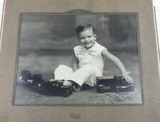 1920's Professional Photography - Child / Boy with Antique Tin Trucks (8 x 10)