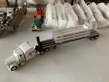 "1/64 DCP White Peterbilt sleeper w/ ""Bradley"" Bulkhead flatbed & corrugated pipe"