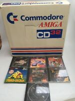 COMMODORE AMIGA CD32 CONSOLE BOXED with Controller and 7 Games