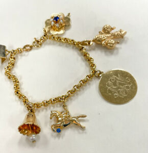 18k Gold Charm Bracelet With Six Charms, Four Leaf Clover, Fleur De Lis, Horse