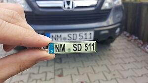 Schlüsselanhänger leuchtet  mit KFZ-Kennzeichen für Ihr Auto