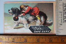 ADV. TRADE CARD WARNER'S SAFE CURE W/ CHILD RIDING ON TOP OF B&W DOG 1026