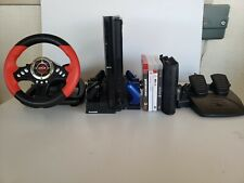 PlayStation 3 (PS3) + 2 Controllers +10 Games+ Charging Station+ Driving Wheel