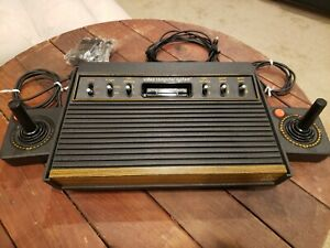 """Atari 2600 console 6 switch """"woody"""" with controllers, and games"""