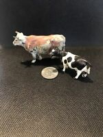 Lot Of 2 Cow Figurines One Ceramic One Stamped Made In England