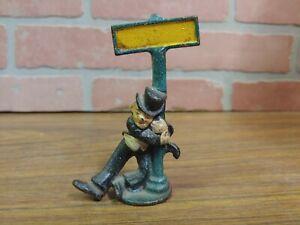 Vintage Cast Iron Painted Figural Bottle Opener Drunk Man Leaning on Sign Pole