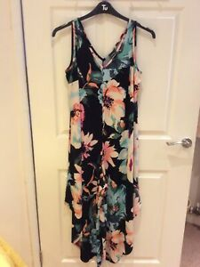 BNWOT Sleeveless Jumpsuit By Coco Bianco (QVC)Size Medium, Multi Floral Pattern.