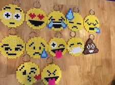 12 moji keychains made from perler beads