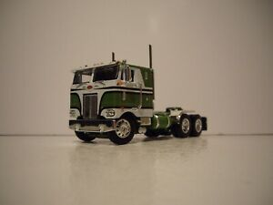 DCP FIRST GEAR 1/64 GREEN AND WHITE PETE 352 WITH 86'' SLEEPER CAB