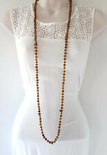 "Boho style 48"" long brown & gold tone glass long rope bead style necklace"